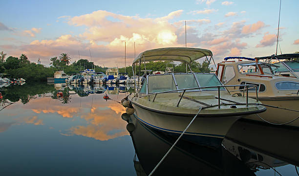 Boats at Sunrise, in Calm Water stock photo