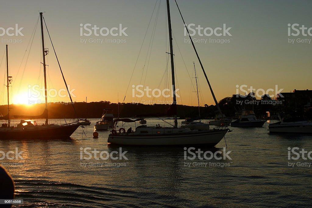 boats at sunset royalty-free stock photo
