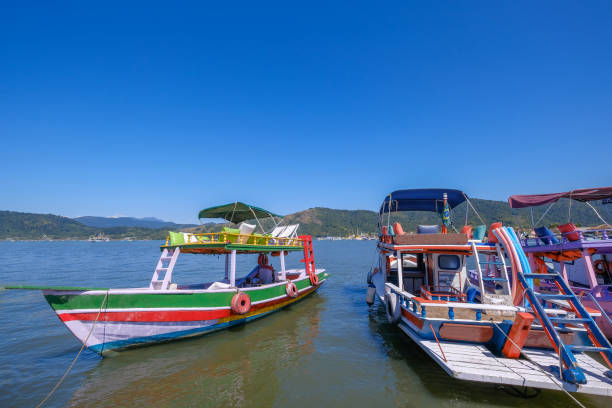 Boats at the channel of the historic town Paraty, Rio de Janeiro state, Brazil stock photo