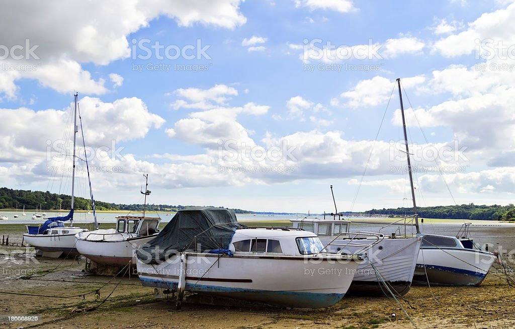 Boats beside the River Orwell at low tide royalty-free stock photo