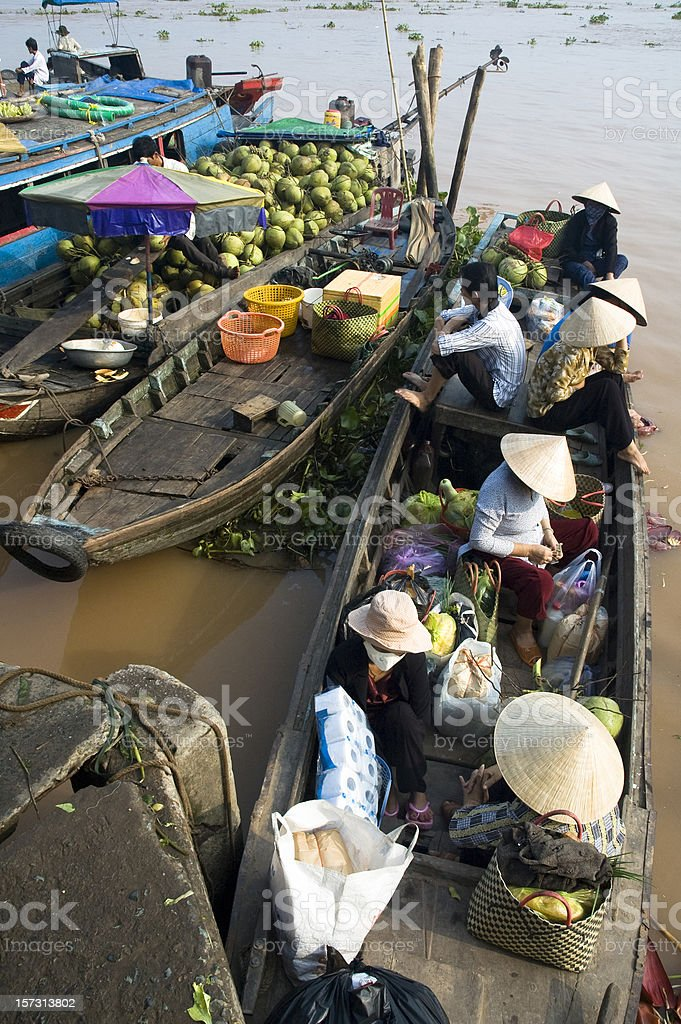 Boats Bring Passengers To Vinh Long Market In Vietnam stock photo
