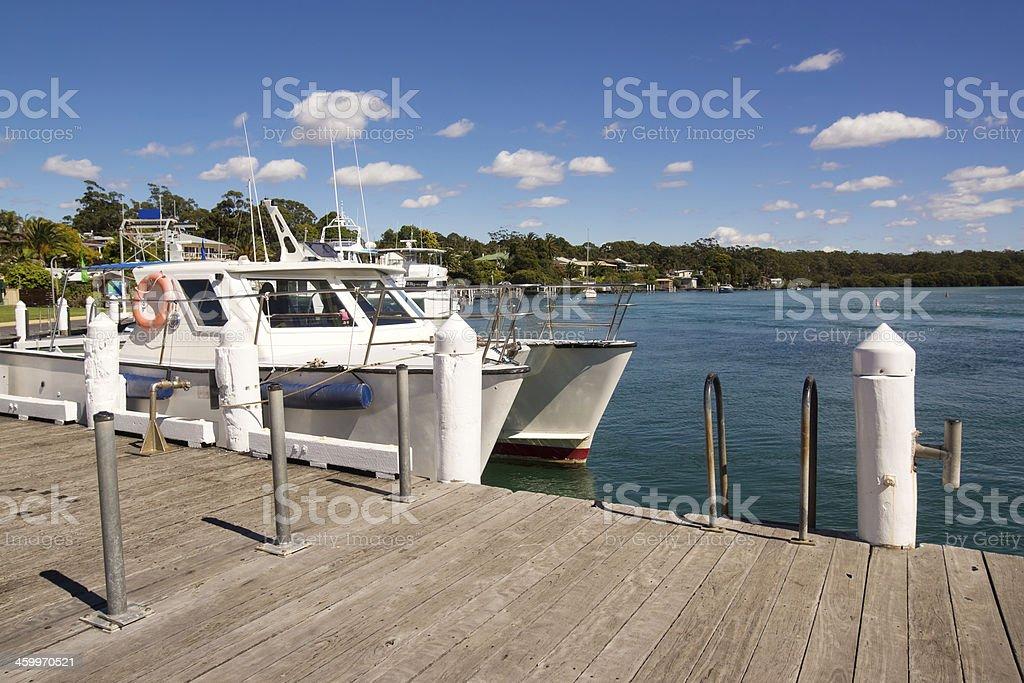 Boats docked at Huskisson harbor, New South Wales stock photo
