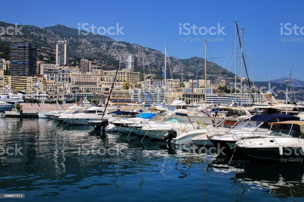 Boats docked at Port Hercules in La Condamine ward, Monaco. stock photo