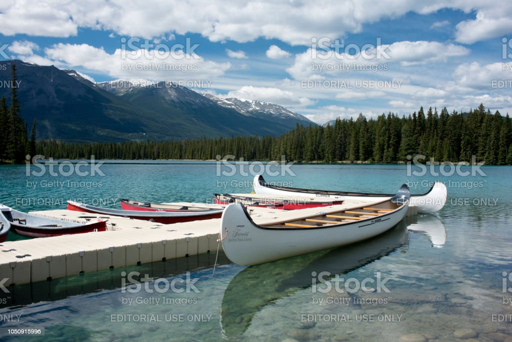Boats docked in Lac Beauvert at Fairmont Jasper Park Lodge in Jasper National Park stock photo