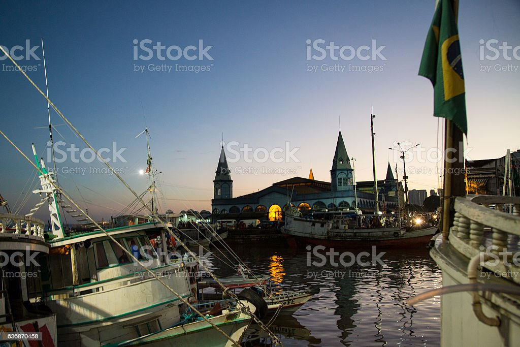 Boats docking at the sunrise at Mercado Ver-o-Peso, Belém, Brazil stock photo
