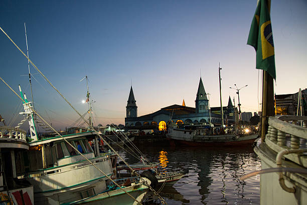 Boats docking at the sunrise at Mercado Ver-o-Peso, Belém, Brazil stock photo