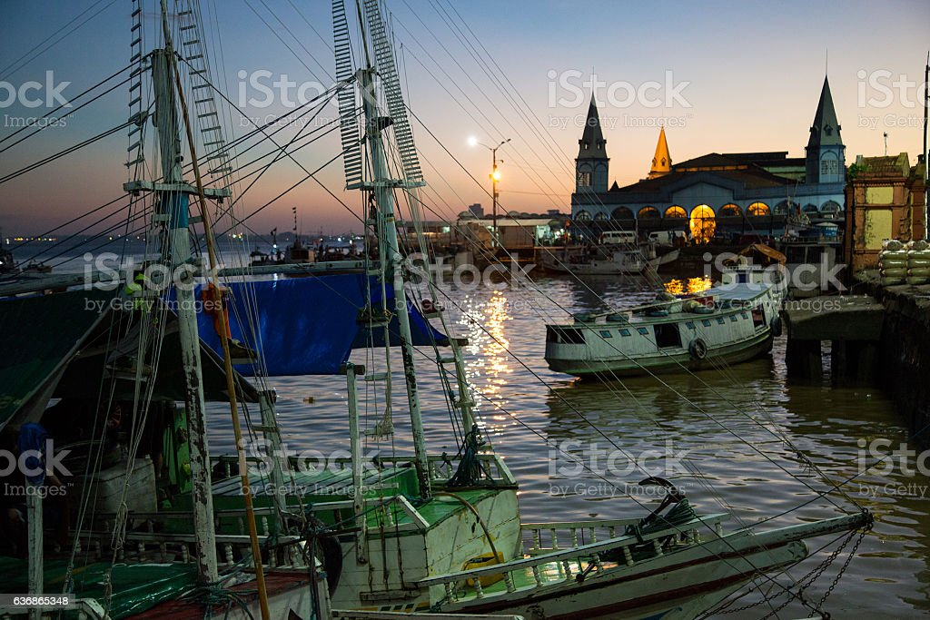 Boats docking at the sunset at Mercado Ver-o-Peso, Belém, Brazil stock photo