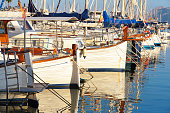 Boats docking in the marina in Port d'Alcudia is a popular resort town and holiday destination on the northeast coast of Mallorca island. Spain