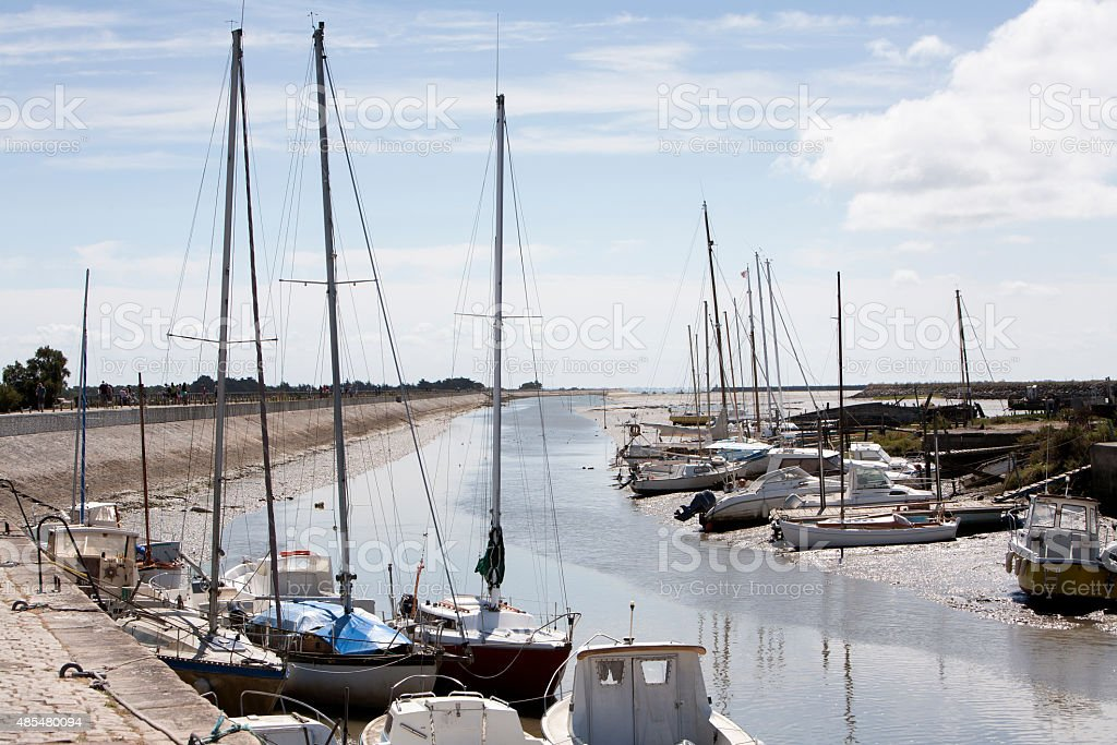 Boats falling dry at low tide in Noirmoutier stock photo