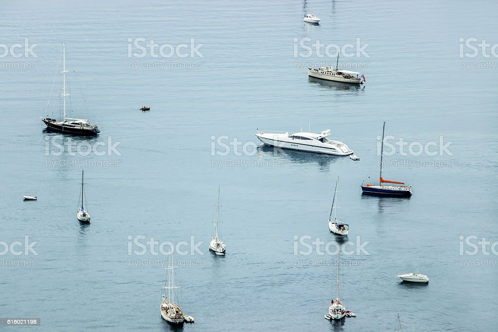 boats floating in ocean stock photo