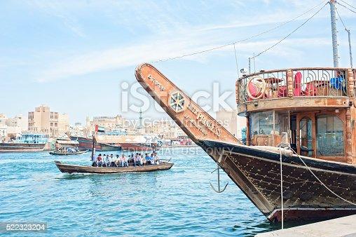 Dubai, United Arab Emirates - April 7 2016 : Traditional Abra (water taxi) crossing the Dubai Creek between Deira and Bur Dubai