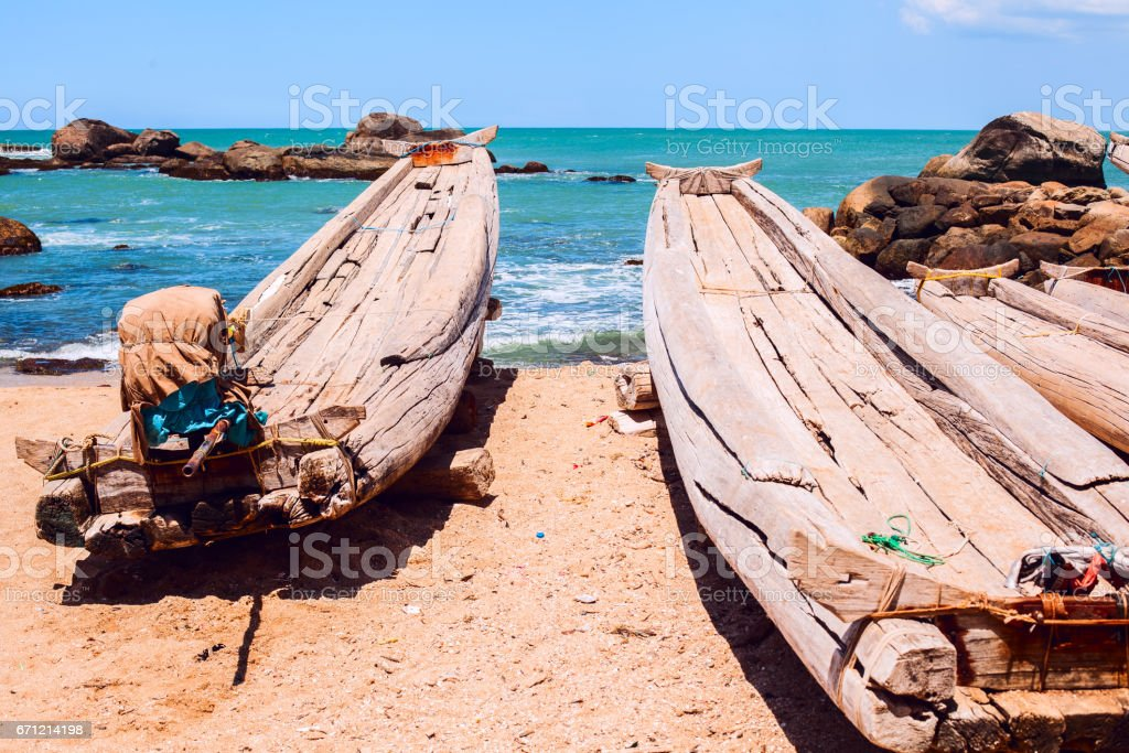 Boats from logs with motor stock photo