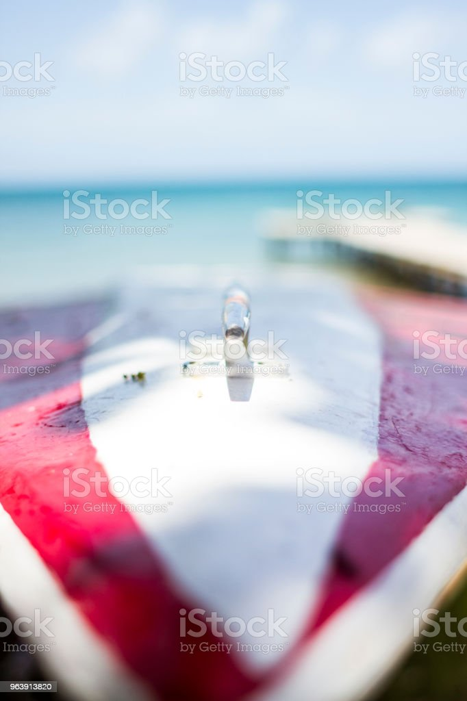 Boat's front with view of pier and ocean stock photo