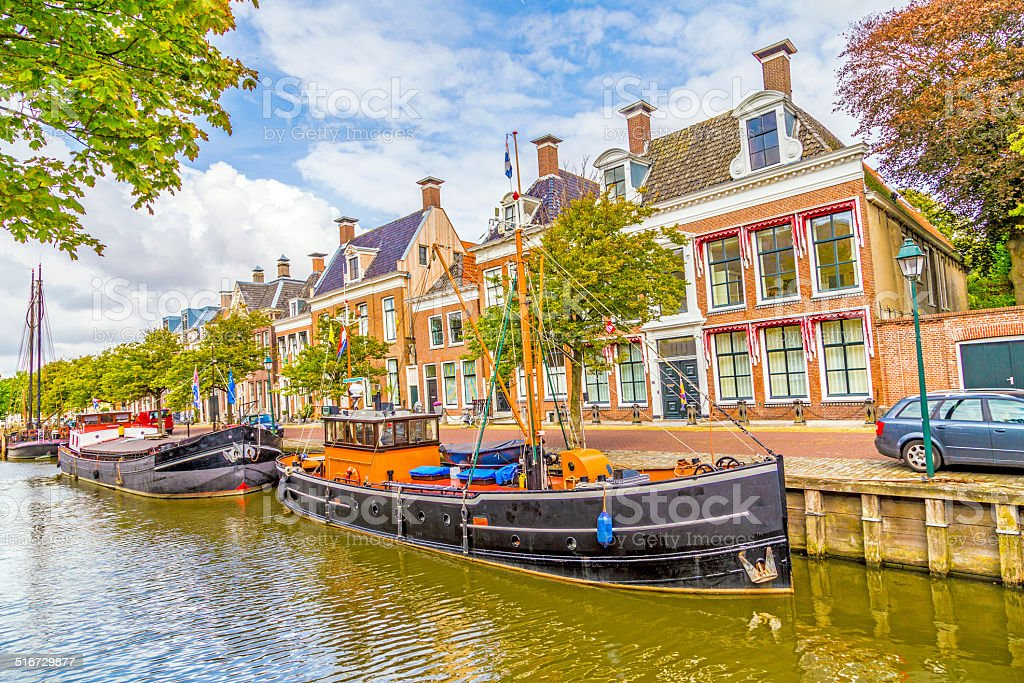 boats in a canal in Harlingen stock photo