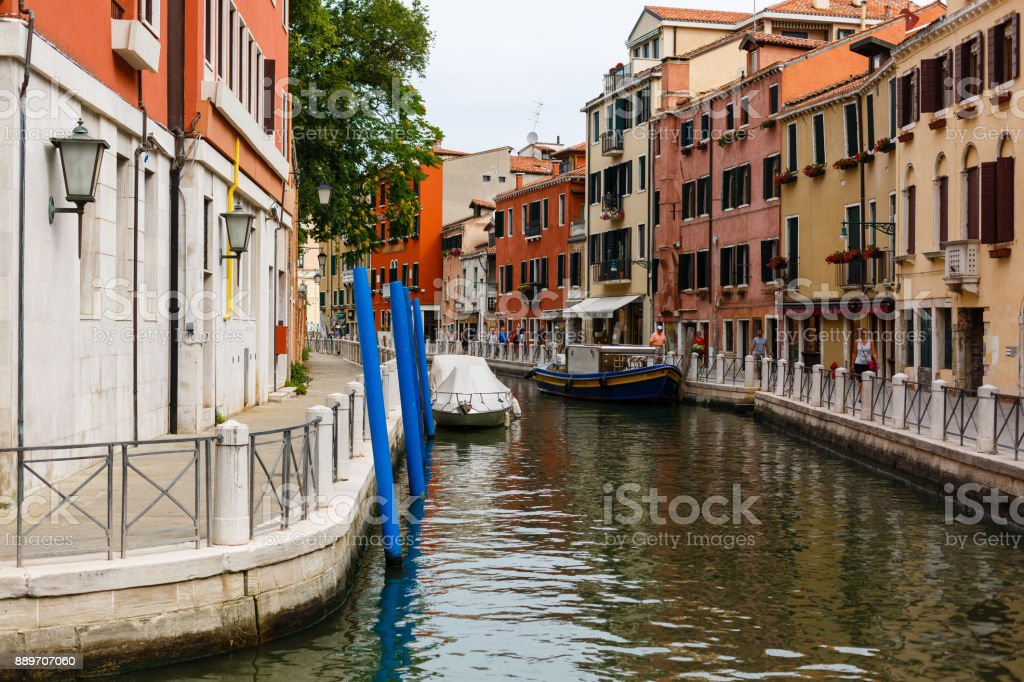 Boats in a narrow canal of venice stock photo