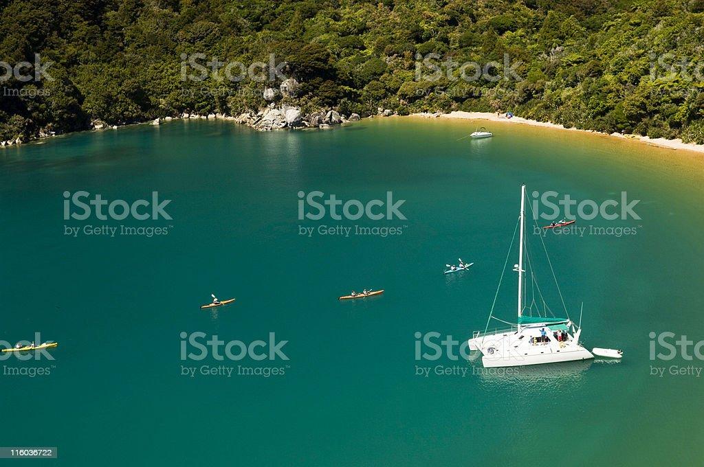Boats in Abel Tasman Bay stock photo