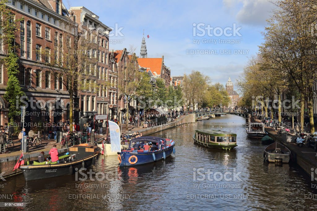 Boats in an Amsterdam canal in Holland stock photo