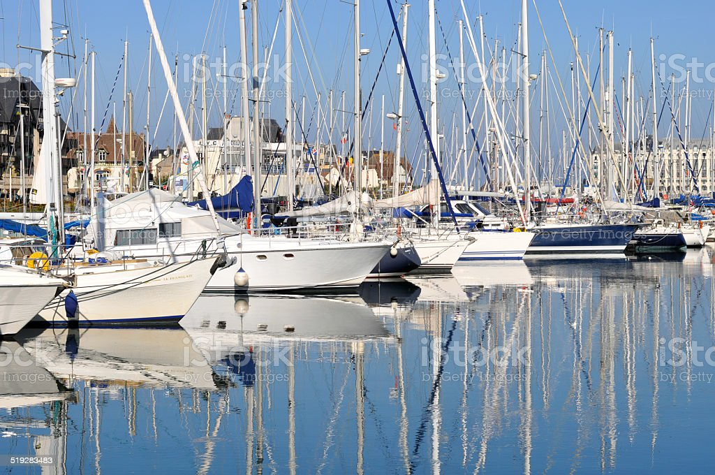 Boats in Deauville on a beautiful sunny day stock photo