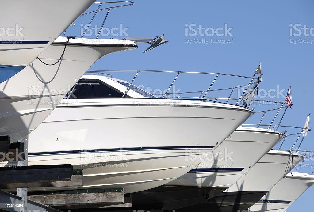 Boats in dry moorage slips stock photo
