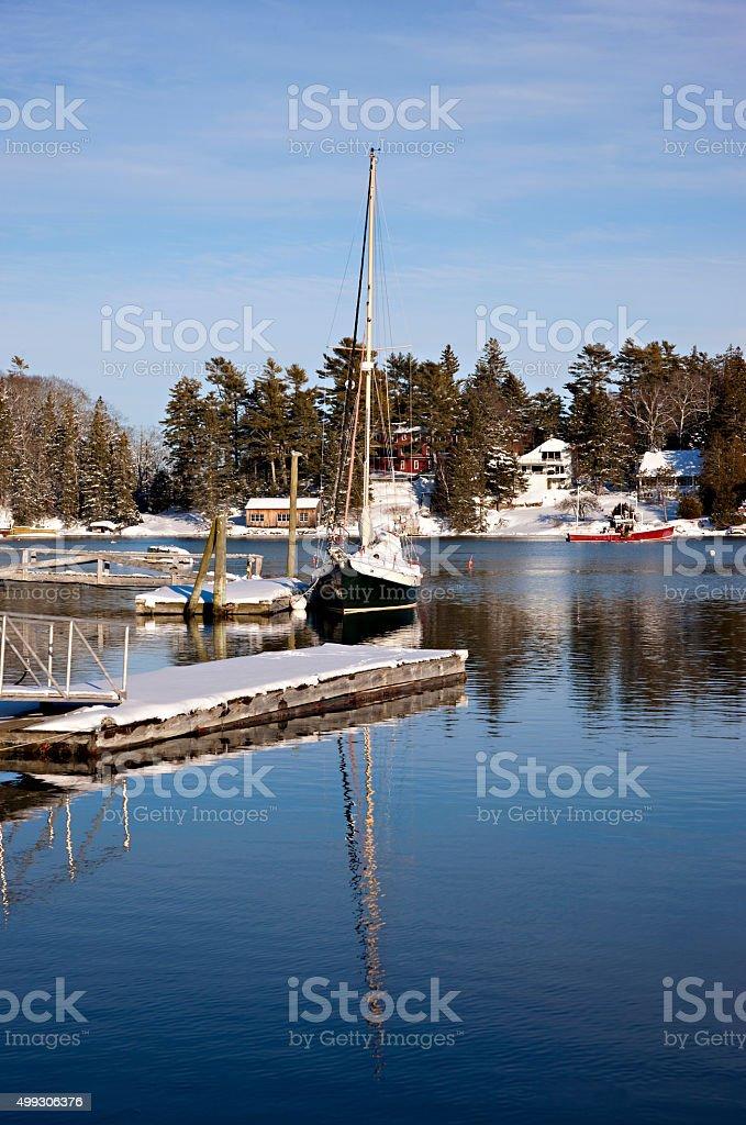 Boats in harbor in winter stock photo