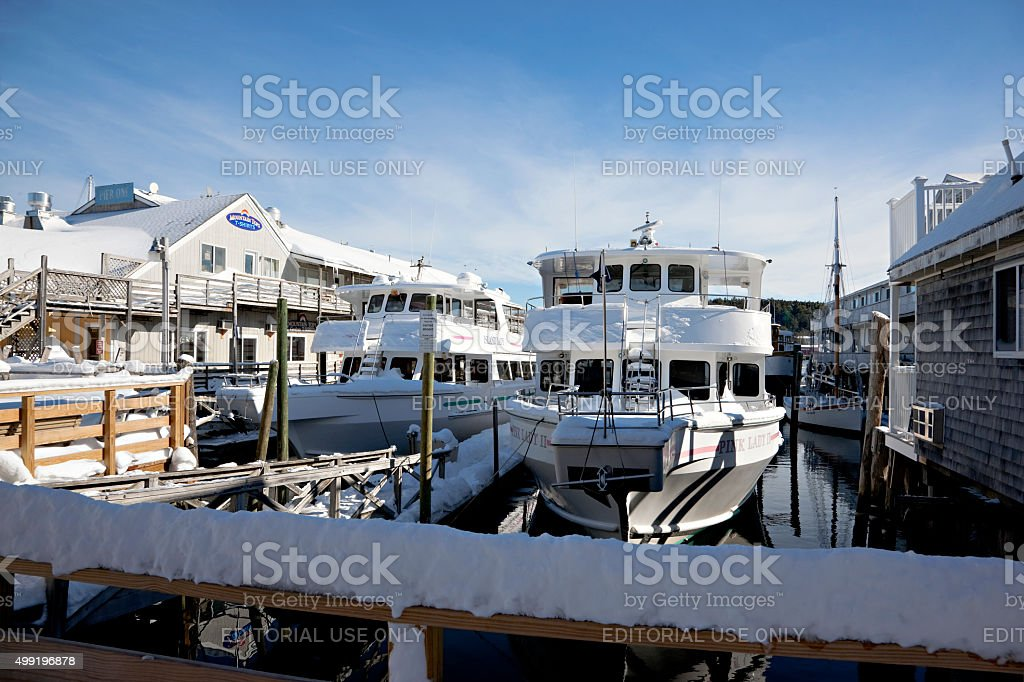 Boats in Maine after snowstorm stock photo