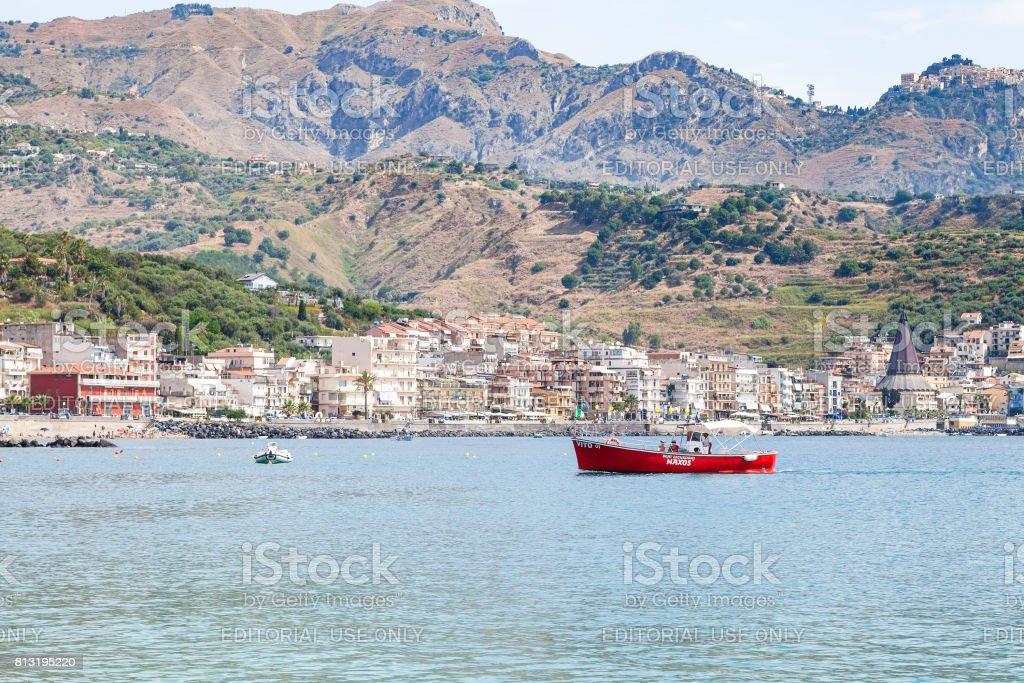 boats in sea near waterfront of Giardini Naxos stock photo