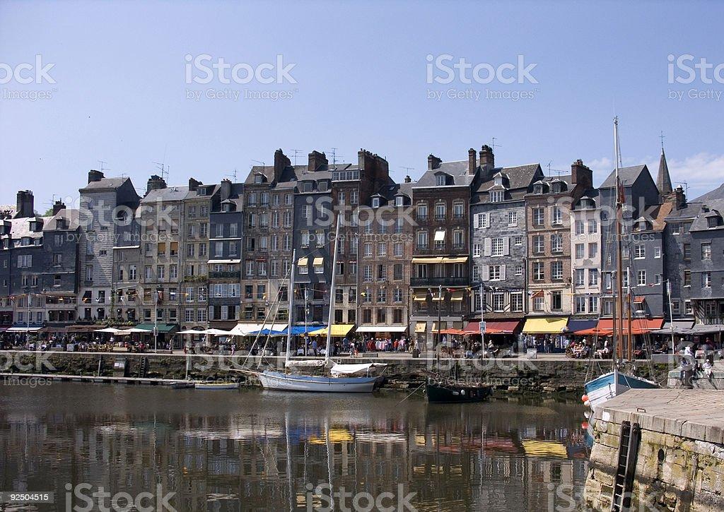 Boats in sunny coastal harbour royalty-free stock photo
