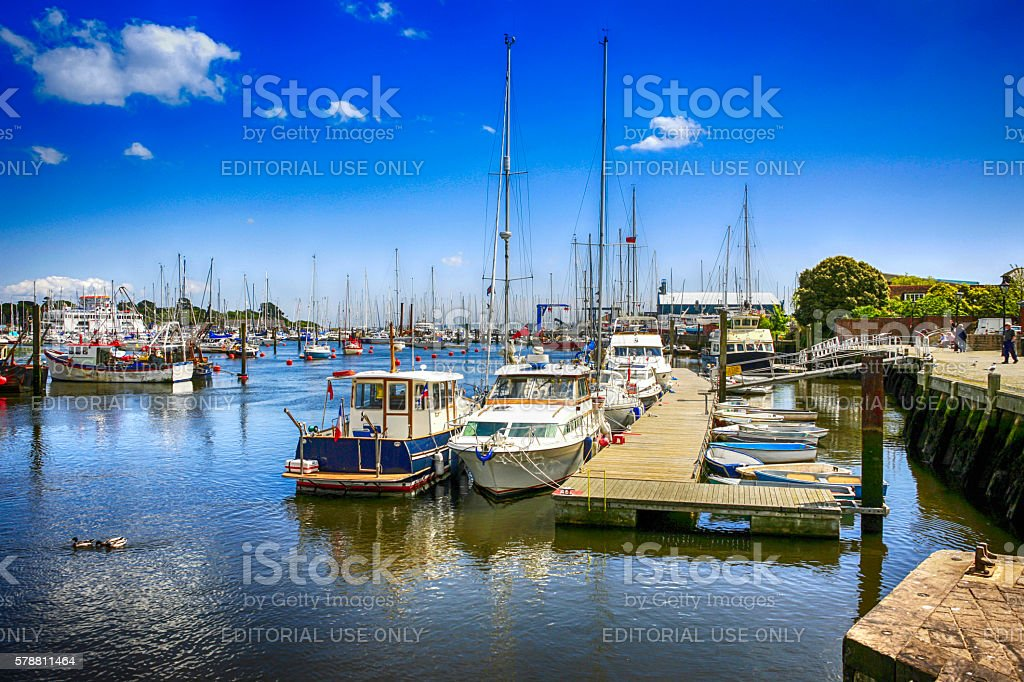 Boats in the harbour and marina in Lymington, UK stock photo