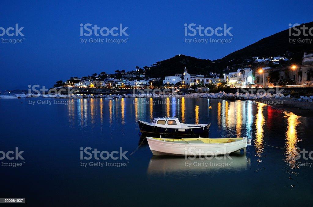 boats in the night reflex stock photo