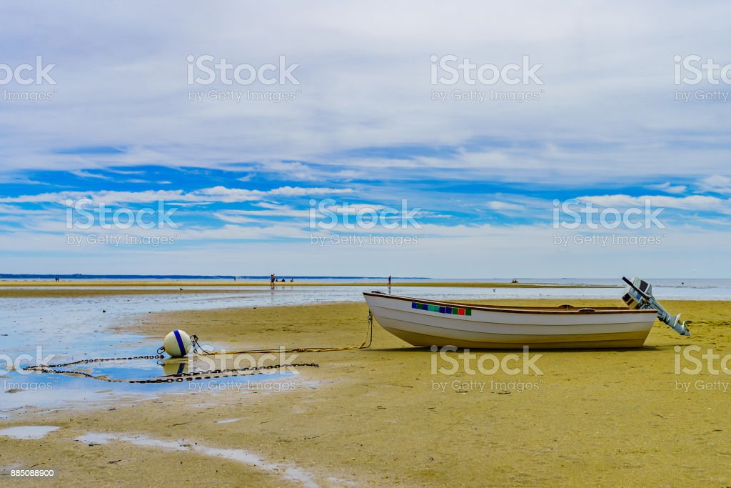 Boats in the Provincetown Coast at low tide MA stock photo