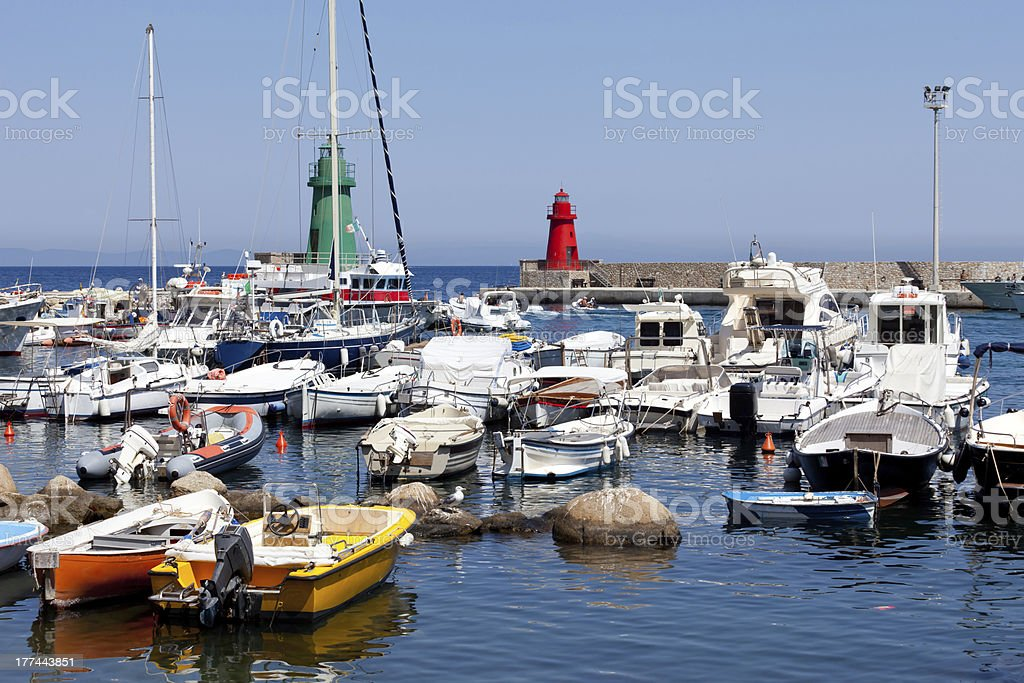 Boats In The Small Port Of Giglio Island stock photo