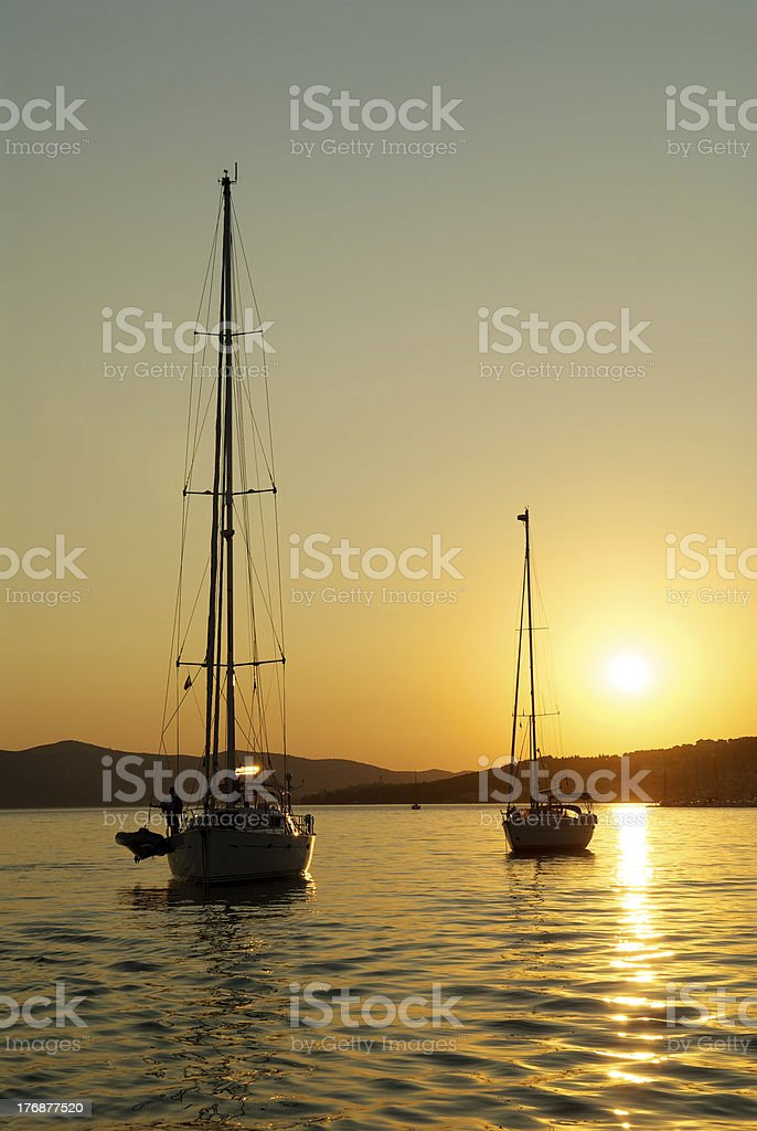 boats in the sunset stock photo