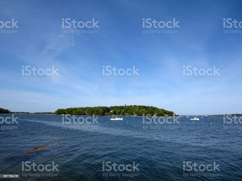 Boats in the water in front of Littlejohn Island, Yarmouth, Maine stock photo
