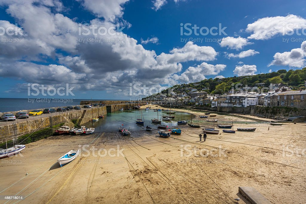 boats in traditional fishing harbour of mousehole at Cornwall stock photo