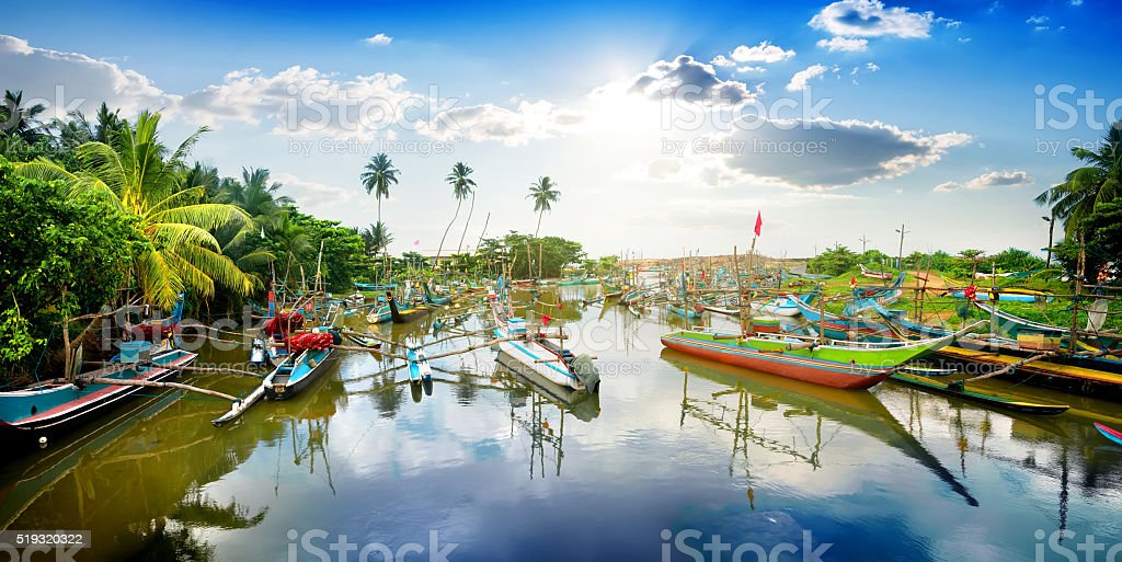 Boats in tropical bay stock photo