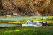 Boats in Mountain river Wadi Shab in Oman with emerald green water