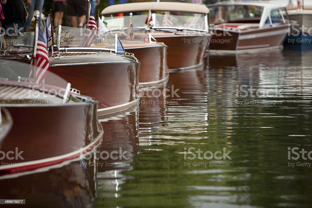 Boats lined up at a dock stock photo