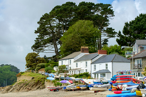 Boats lined up at the top of the beach in boating centre Helford Passage, Cornwall, UK.