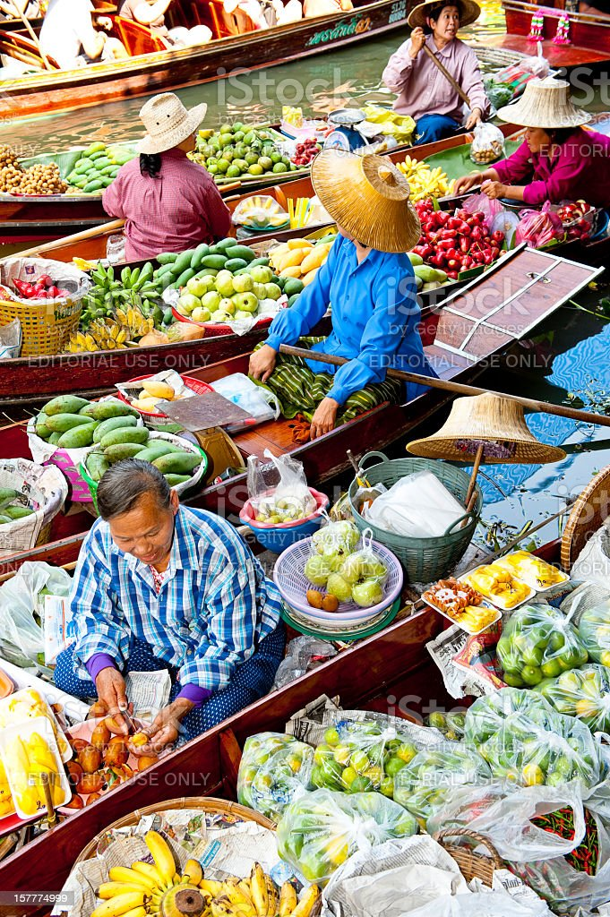 Boats loaded with fruits in Damnoen Saduak Floating Market, Thailand stock photo