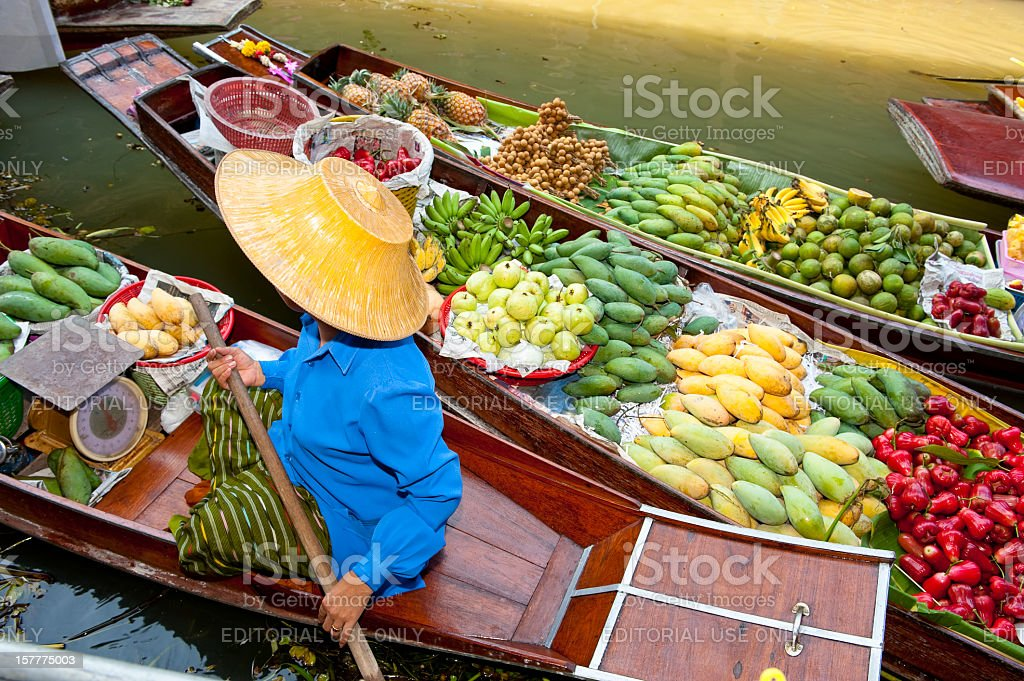 Boats loaded with fruits in Damnoen Saduak Floating Market, Thailand stock photo