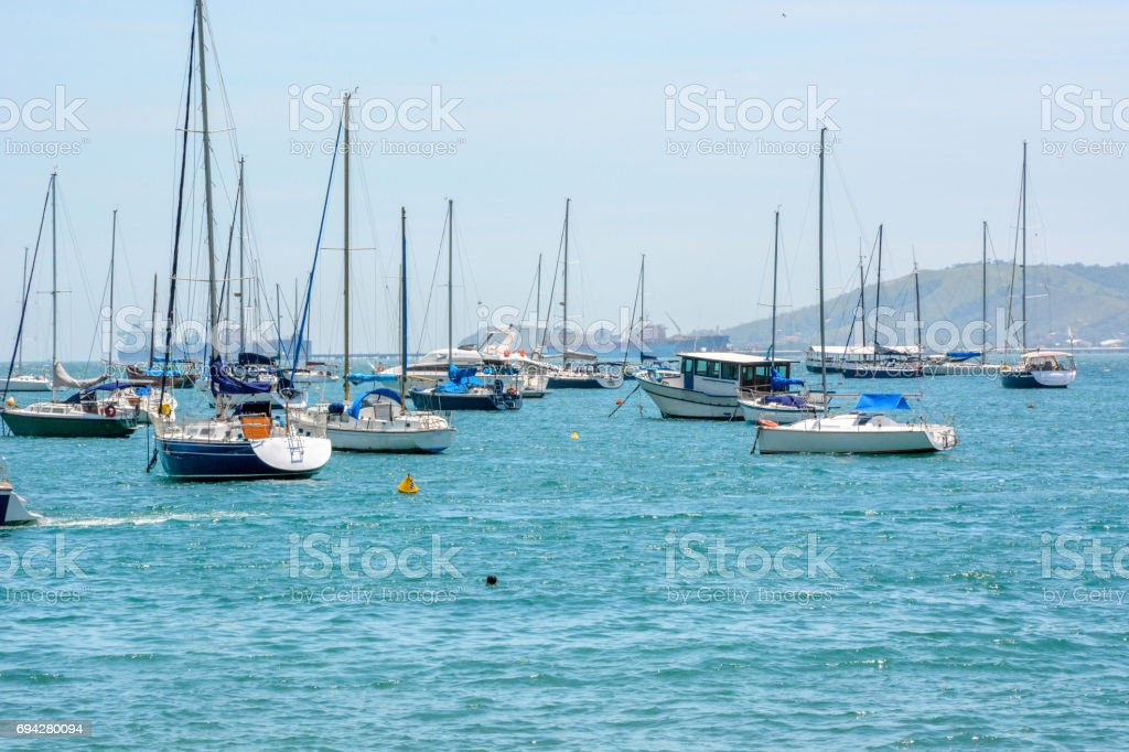 Boats moored at a calm bay in Ilhabela, São Paulo, Brazil stock photo