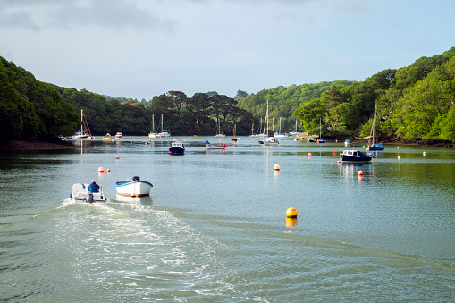 Boats moored at old fashioned Port Navas in the Helford Estuary, Cornwall, UK