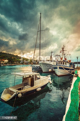 Boats moored at small marina on Adriatic sea.