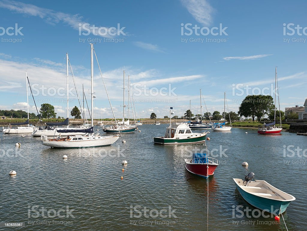 Boats moored at yacht club stock photo