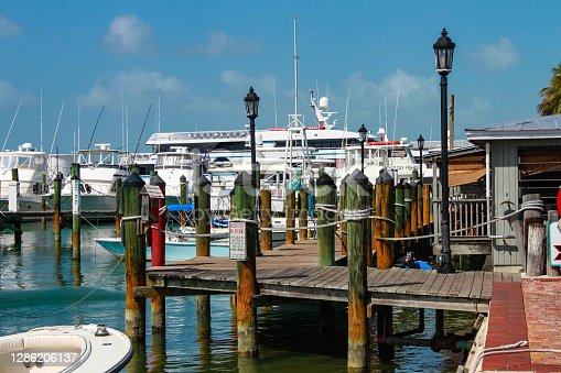 istock Boats moored by the Historical Seaport in Key West Florida USA 1286206137
