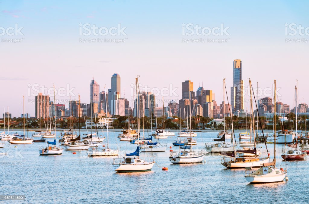 Boats moored in St Kilda, in front of the Melbourne skyline stock photo