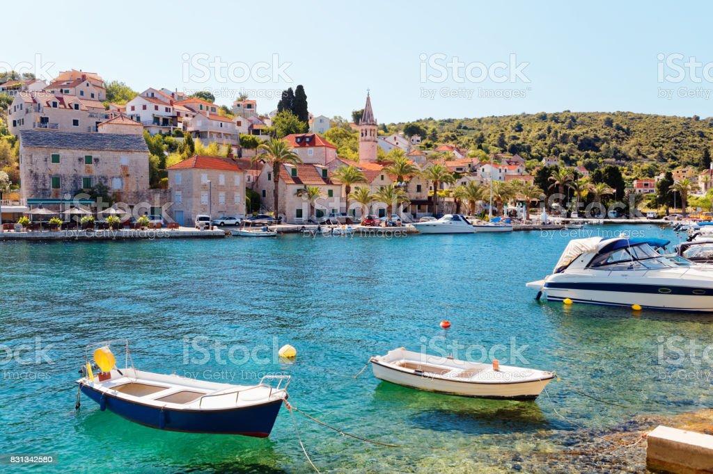 Boats moored in the harbor of a small town Splitska - Croatia, island Brac stock photo