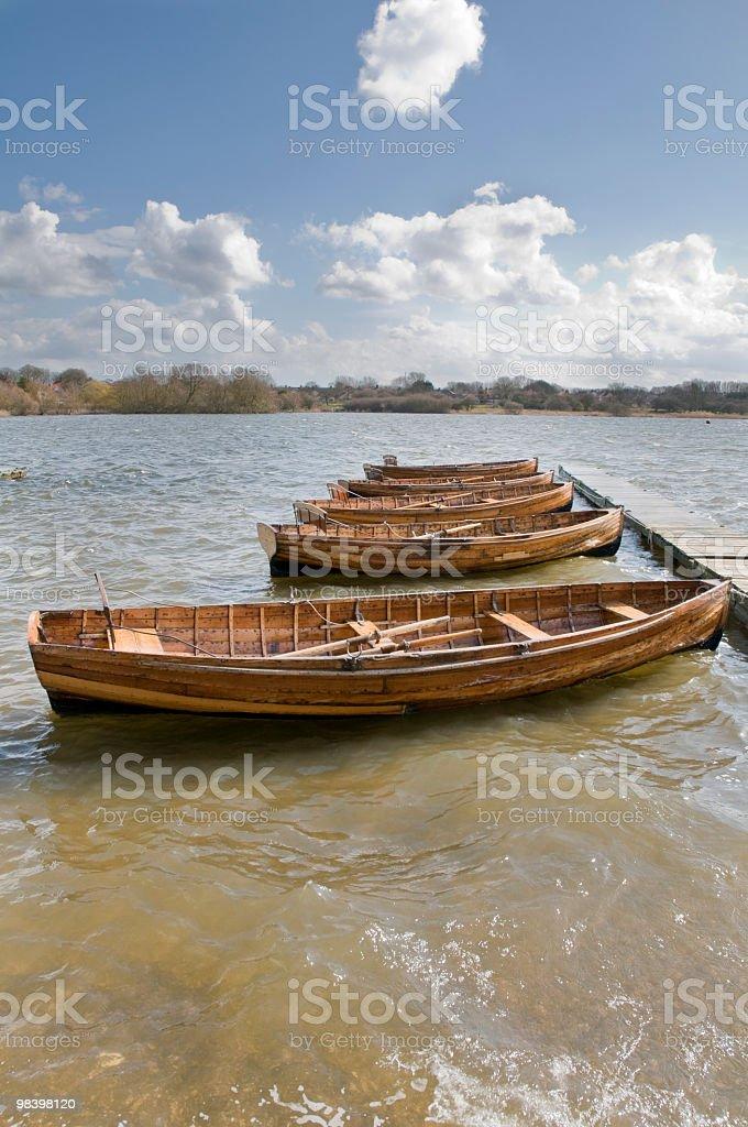Boats moored to jetty royalty-free stock photo