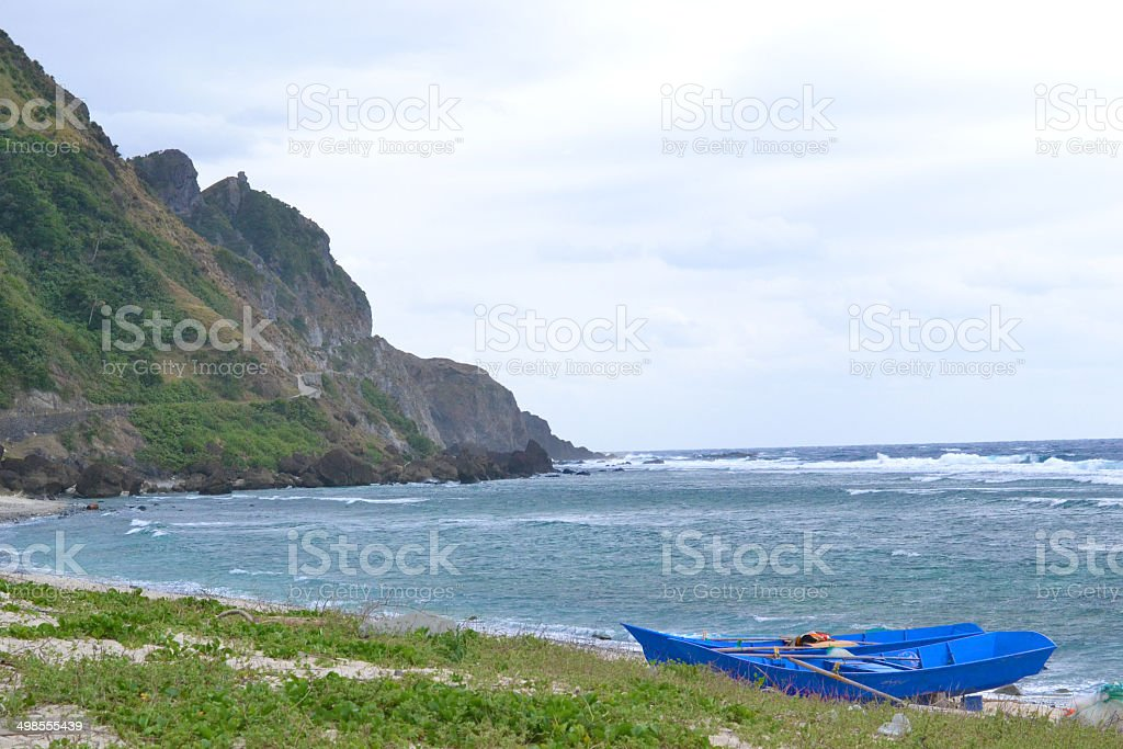 Boats, Mountains and the Sea. stock photo