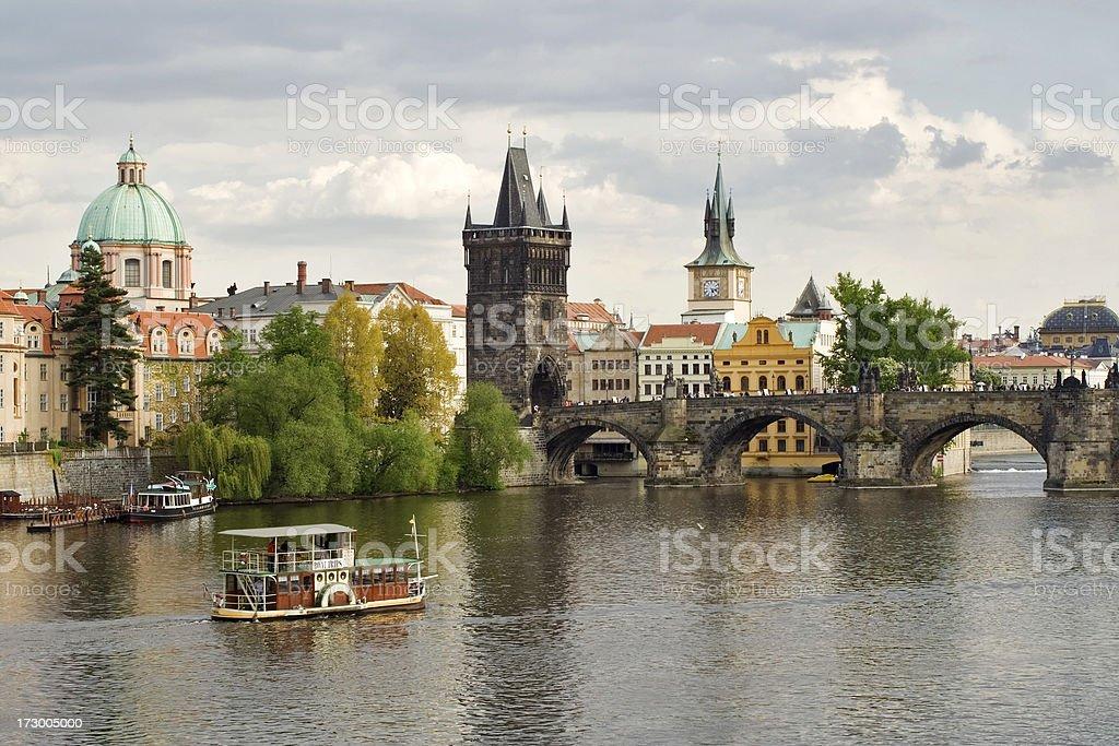 Boats near Charles bridge in Prague royalty-free stock photo